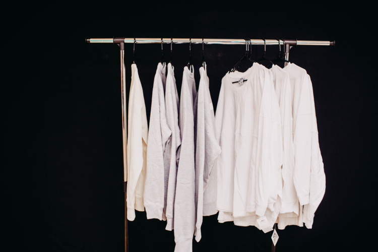 Opens white apparel hanging with a black background in a new tab to view in higher resolution